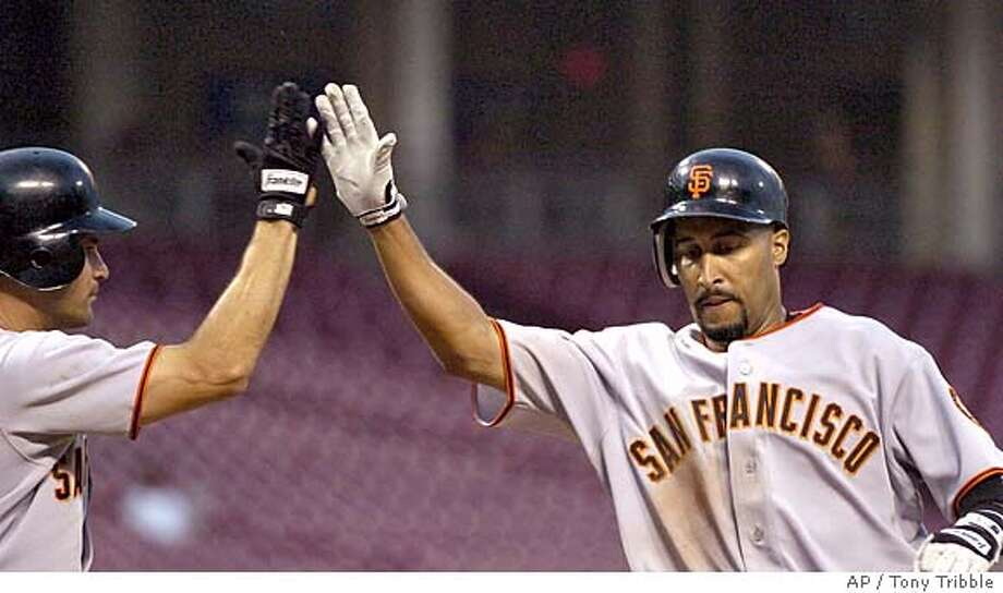 San Francisco Giants Randy Winn, right, gets congratulated by teammate Omar Vizquel after hitting a home run off Cincinnati Reds Aaron Harang in the third inning in Cincinnati Monday Aug. 15, 2005.(AP Photo/Tony Tribble) Photo: TONY TRIBBLE