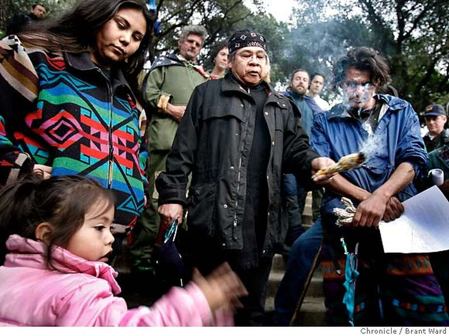 stadium233.JPG  L-R Morning Star Gali and her daughter Talissa, Wounded Deocampo, and Zachary Running Wolf (blue shirt) were among the activists calling on the university to save the tree area where native Americans are buried.  At the tree grove in front of Memorial stadium on the UC Berkeley campus, activists were joined by native Americans in demanding the university not dig up human remains they say are buried here. A tree-sitting protest has been going on for months to save oak and redwood trees scheduled to be removed for a new athletic complex.  {Brant Ward/San Francisco Chronicle}2/20/07 Photo: Brant Ward