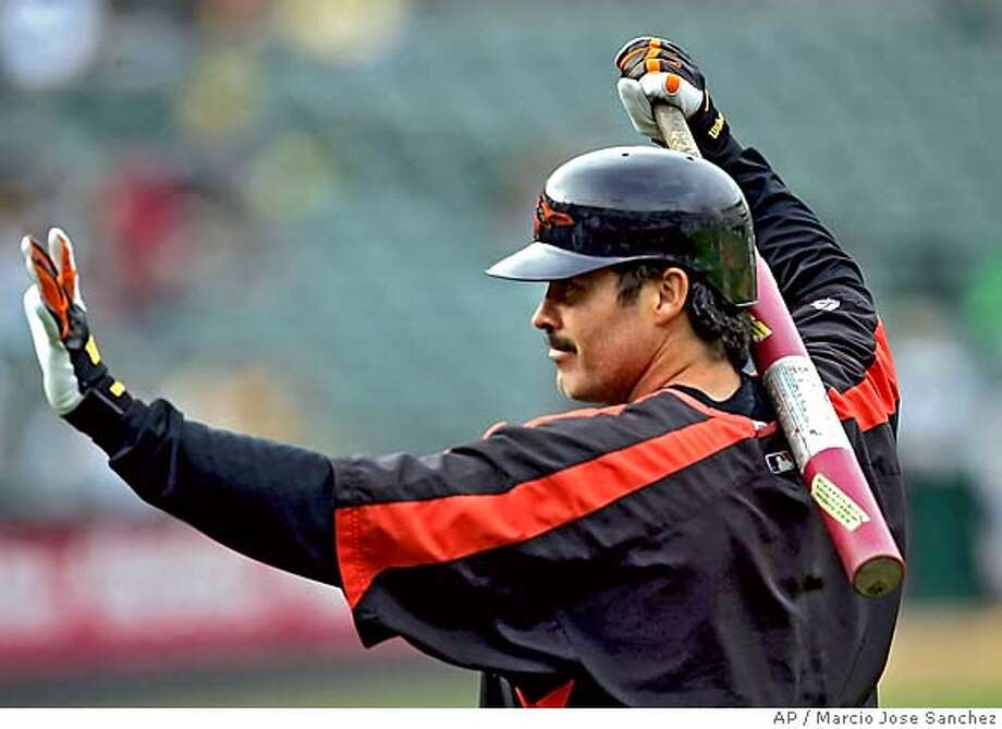Batimore Orioles' Rafael Palmeiro waves to fans as he prepares to take batting practice before the start of a game against the Oakland Athletics on Monday, Aug. 15, 2005 in Oakland, Calif. (AP Photo/Marcio Jose Sanchez) Photo: MARCIO JOSE SANCHEZ