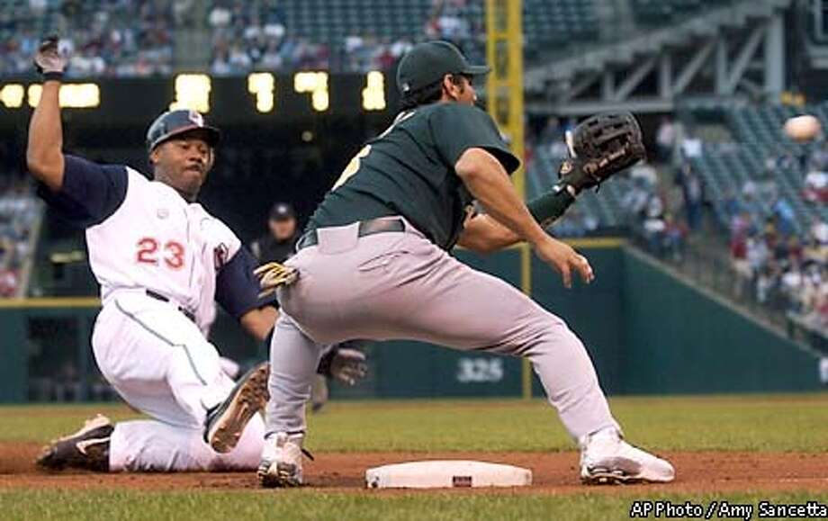 Cleveland Indians' Ellis Burks, left, is out stealing third base as Oakland Athletcis third baseman Eric Chavez makes the play in the fourth inning at Jacobs Field, Saturday, May 17, 2003, in Cleveland. (AP Photo/Amy Sancetta) Photo: AMY SANCETTA