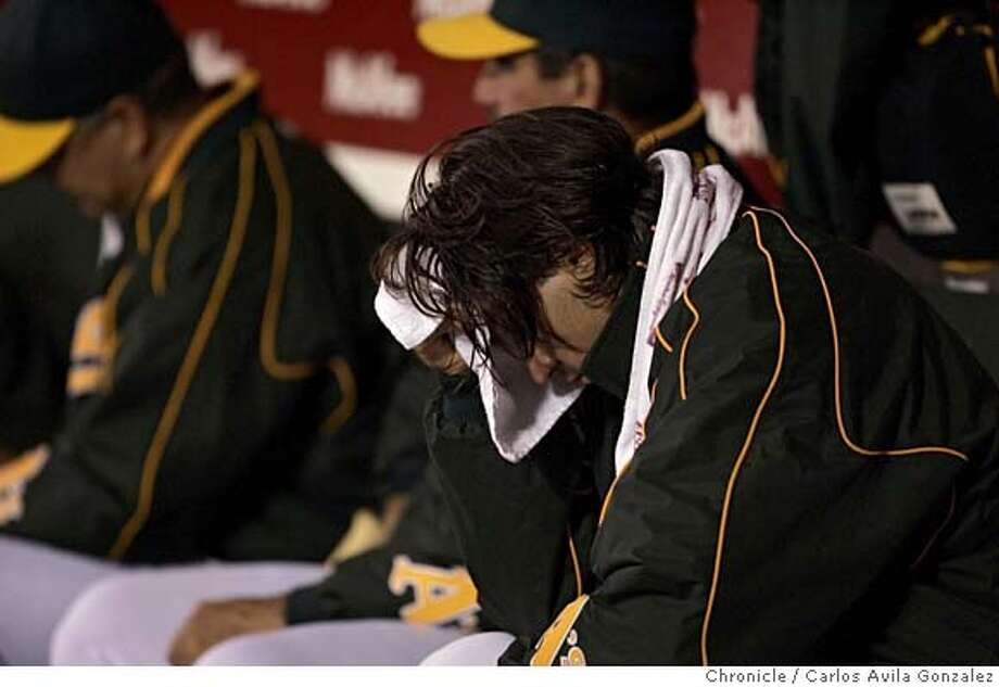 ATHLETICS16_187_CG.JPG  Oakland's starting pitcher, Barry Zito, hangs his head down after being pulled from the game in the top of the seventh inning of play. The Oakland Athletics played the Baltimore Orioles at McAfee Coliseum in Oakland, Ca., on Monday, August 15, 2005.  Photo by Carlos Avila Gonzalez / The San Francisco Chronicle  Photo taken on 8/15/05, in Oakland,CA. Photo: Carlos Avila Gonzalez