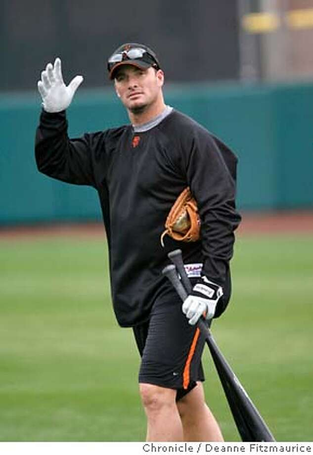 giants_0192_df.jpg  Mark Sweeney (cq) waves to somebody in the stands. Some of the position players arrive early to workout the day before the position players are required to workout. San Francisco Giants have a Spring Training workout at Scottsdale Stadium. Photographed in Scottsdale on 2/19/07. Chronicle Photo / Deanne Fitzmaurice Mark Sweeney (cq) Mandatory credit for photographer and San Francisco Chronicle. No Sales/Magazines out. Photo: Deanne Fitzmaurice