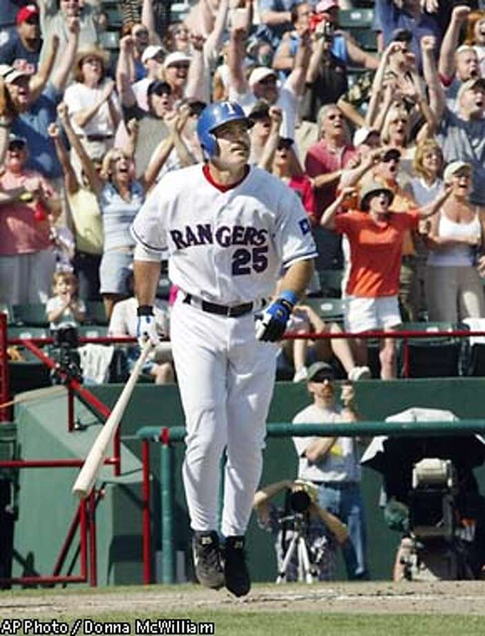 Texas Rangers' Rafael watches as the ball clears the fence after he hit his 500th career home run against the Cleveland Indians in the seventh inning, Sunday, May 11, 2003, in Arlington, Texas. On Sunday, became the only member of the 500 homer club to have led the league in singles or had a 500 at-bat season with less than 10 homers. (AP Photo/Donna McWilliam) Photo: DONNA MCWILLIAM