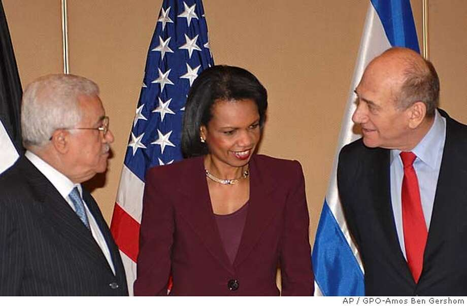 In this photo released by Israel's Government Press Office, United States Secretary of State Condoleezza Rice, center, Palestinian Authority President Mahmoud Abbas, left, and Israeli Prime Minister Ehud Olmert,right, greet each other at a meeting at the David Citadel Hotel in Jerusalem, Monday, Feb. 19, 2007. Bringing Israel's prime minister and the Palestinian president together, Rice was hoping to discuss major issues in general terms, hampered by an incoming Palestinian government that would not explicitly recognize Israel.(AP Photo/GPO-Amos Ben Gershom, HO) ** ISRAEL OUT ** GPO HANDOUT-ISRAEL OUT Photo: AMOS BEN GERSHOM