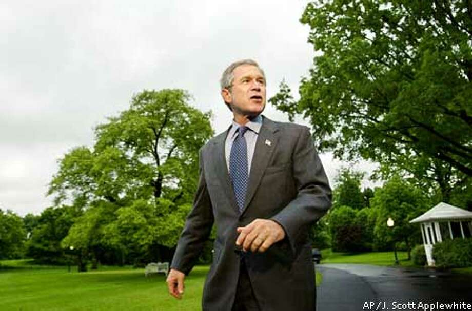 """President Bush said as he was leaving for Camp David, """"The American people will decide whether or not I deserve a second term."""" Associated Press photo by J. Scott Applewhite"""