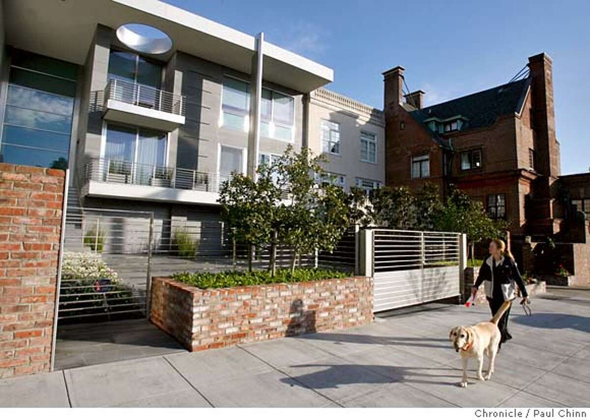 A neighbor walks past a futuristic-looking home across from Alta Plaza Park in San Francisco, Calif. on Thursday, February 15, 2007. PAUL CHINN/The Chronicle MANDATORY CREDIT FOR PHOTOGRAPHER AND S.F. CHRONICLE/NO SALES - MAGS OUT