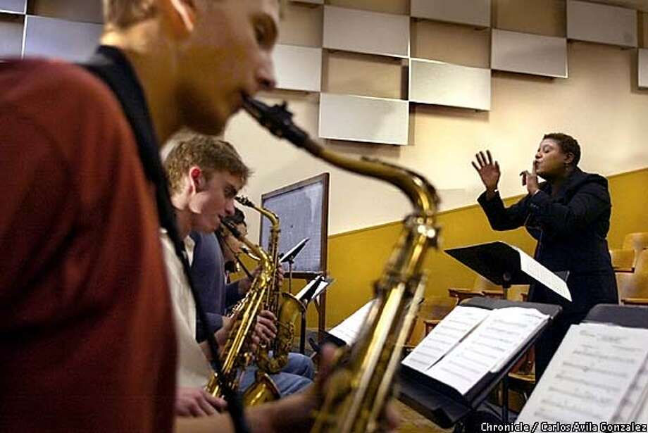 Instructor, Dee Spencer, leads the SF Jazz All-Star High School Ensemble during practice at SF State on Tuesday, May 7, 2003. They are finalists in the Lincoln Center's Essentially Ellington high School Jazz Band Competition, a prestigious event that will be held in New York in mid-May.  Event on 05/06/03 in SAN FRANCISCO, CA. Photo By CARLOS AVILA GONZALEZ / The San Francisco Chronicle Photo: CARLOS AVILA GONZALEZ