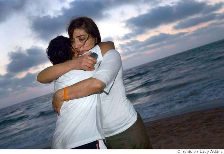 Zipi Ben- Sa'adon holds her youngest son Nadav as he cries at the beach for what could be thier last time in Gush Katiff, Aug. 14, 2005. Zipi Ben-Sa'adon, mother , Yonatan oldest boy, Avsha lom,soldier, Neta, daughter, Nadav, youngest child. A family in a settlement in Gush Katif which is expected to be moved in the disengagement in August. Aug. 11, 2005. Photographer Lacy Atkins Photo: Lacy Atkins