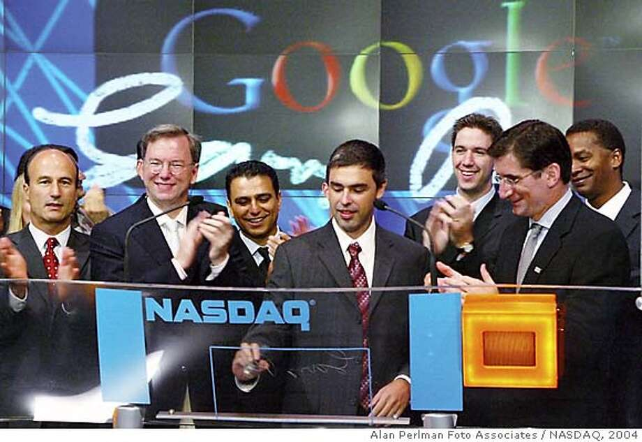 (NYT64) NEW YORK -- August 19, 2004 -- GOOGLE-IPO -- Google Inc.'s co-founder Larry Page is applauded at a ceremony marking the company's initial public offering at the NASDAQ MarketSite in New York on Thursday, August 19, 2004. From left: Google Chief Financial Officer George Reyes; Google CEO Eric Schmidt; Google Senior Vice President Omid Kordestani ; Page; unidentified; NASDAQ President and CEO Robert Greifeld; and Google Vice President David Drummond. (Alan Perlman Foto Associates/NASDAQ/The New York Times) **ONLY FOR USE WITH STORY BY GARY RIVLIN SLUGGED: GOOGLE-IPO. ALL OTHER USE PROHIBITED. ** ALSO RAN 12/24/04  Ran on: 08-20-2004  Google co-founder Larry Page is applauded by company and Nasdaq officials as the online search engine stock premieres. Ran on: 12-24-2004  At the Nasdaq in New York in August, Google's Larry Page (center), company brass and others gather for the firm's IPO. XNYZ, **ONLY FOR USE WITH STORY BY GARY RIVLIN SLUGGED: GOOGLE-IPO. ALL OTHER USE PROHIBITED. ** Photo: ALAN PERLMAN FOTO ASSOCIATES/NAS