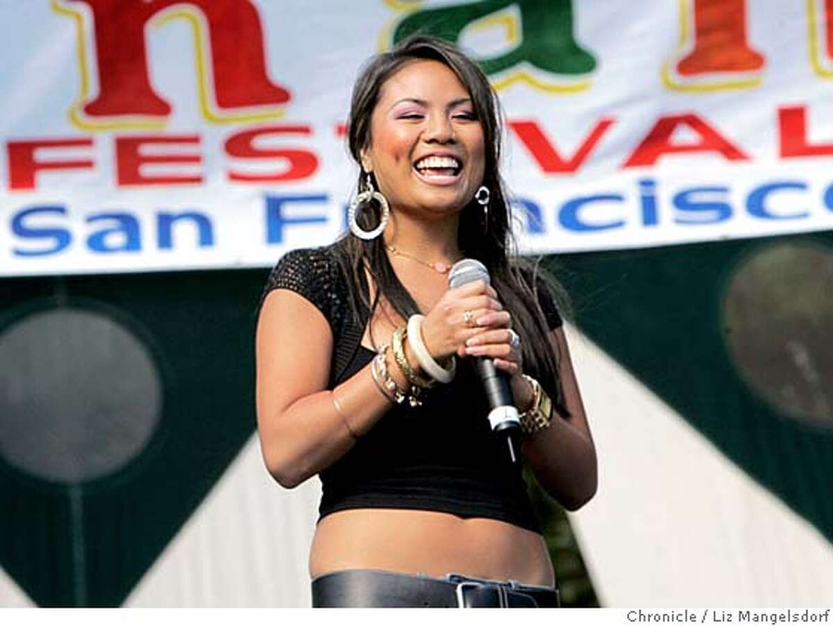 pistahan005_lm.JPG Event on 8/14/05 in San Francisco. Chayah Miranda performs at the Pistahan festival at Yerrba Buena Gardens. The Pistahan Parade and Festival at Yerba Buena Gardens honors the Filipino community and included booths, and singers and dancers on two stages. The festival was on both Saturday and Sunday. Liz Mangelsdorf / The Chronicle MANDATORY CREDIT FOR PHOTOG AND SF CHRONICLE/ -MAGS OUT
