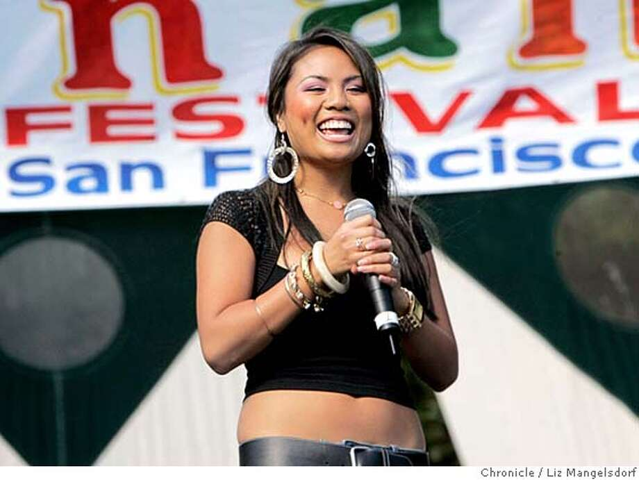 pistahan005_lm.JPG Event on 8/14/05 in San Francisco.  Chayah Miranda performs at the Pistahan festival at Yerrba Buena Gardens. The Pistahan Parade and Festival at Yerba Buena Gardens honors the Filipino community and included booths, and singers and dancers on two stages. The festival was on both Saturday and Sunday. Liz Mangelsdorf / The Chronicle MANDATORY CREDIT FOR PHOTOG AND SF CHRONICLE/ -MAGS OUT Photo: Liz Mangelsdorf