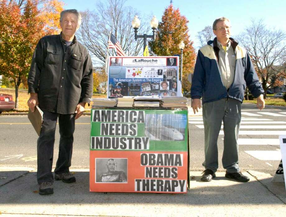 Joe Billington, left, of Philadelphia,P and Bob Wesser of Hackensak, NJ , both members of the LaRouche Politicla Action Committee, stand in from of the Bethel Post Office Thursday, October 29, 2009 Photo: Carol Kaliff / The News-Times