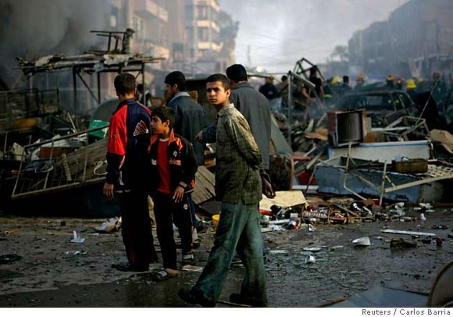 An Iraqi boy walks at a destroyed market after a car bomb explosion in the neighbourhood known as New Baghdad, southeast of Baghdad, February 18, 2007. Two car bombs tore through a busy shopping area of a mainly Shi'ite district of Baghdad on Sunday, killing 55 people and wounding scores as militants defied a military offensive by U.S. and Iraqi troops. REUTERS/Carlos Barria (IRAQ) 0 Photo: CARLOS BARRIA