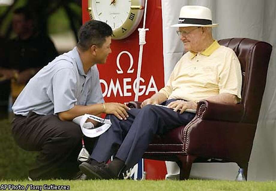 PGA golfer K.J. Choi, of Seoul, South Korea, left, kneels down to chat with legendary golfer Byron Nelson prior to teeing off during the opening round of the Byron Nelson Championship, Thursday, May 15, 2003, in Irving, Texas. (AP Photo/Tony Gutierrez) Photo: TONY GUTIERREZ