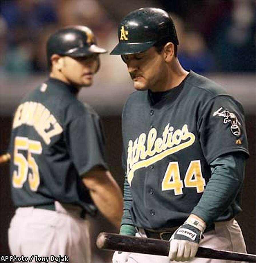 Oakland Athletics' Erubiel Durazo (44) walks back to the dugout after striking out in the ninth inning against Cleveland Indians' Danys Baez Friday, May 16, 2003 at Jacobs Field. Athletics' Ramon Hernandez (55), who struck out for the final out, is in the background. The Indians won 3-2. (AP Photo/Tony Dejak) Photo: TONY DEJAK