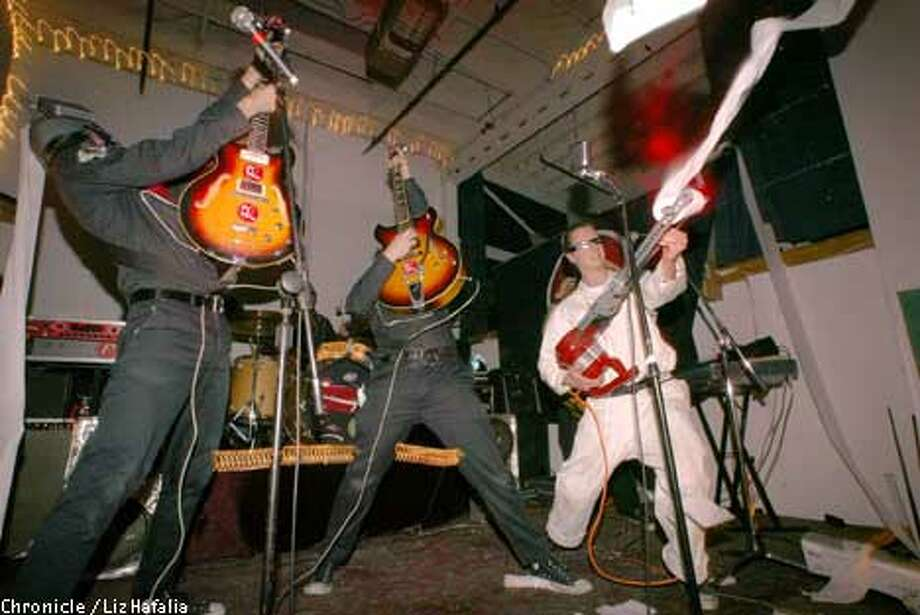 The Phenomenauts take the stage while hosting a party in their Oakland warehouse space. Chronicle photo by Liz Hafalia