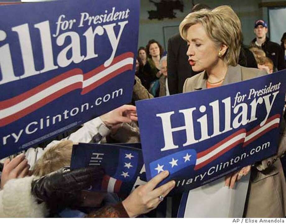 Supporters hold signs to be autographed as Democratic presidential hopeful Sen. Hillary Rodham Clinton, D-N.Y., campaigns at a town meeting in Dover, N.H. Saturday, Feb. 17, 2007. (AP Photo/Elise Amendola) Photo: Elise Amendola