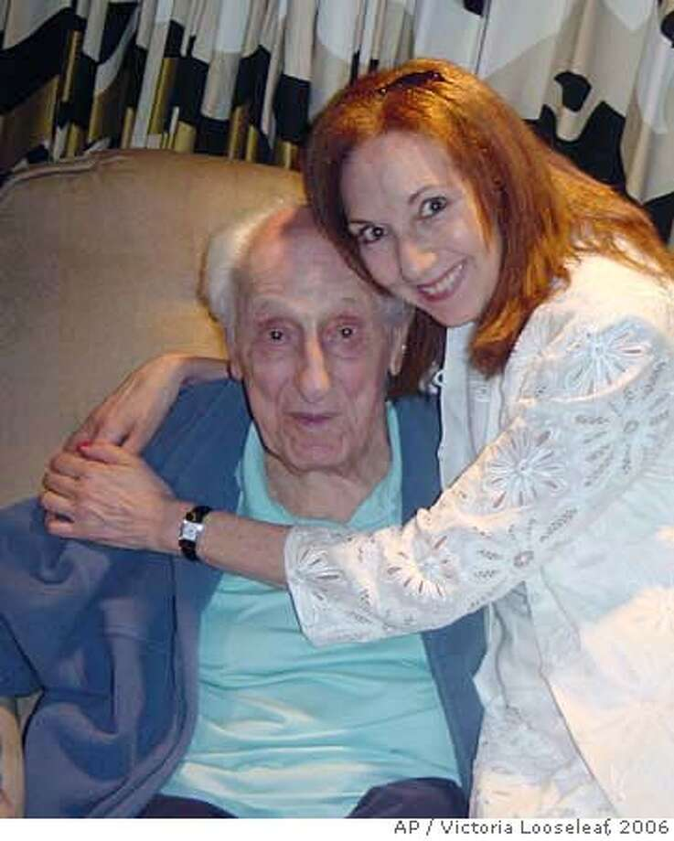 """This image provided by Victoria Looseleaf shows Looseleaf with Ray Evans in August 2006 in Beverly Hills, Calif. Oscar-winning songwriter Ray Evans, whose long collaboration with partner Jay Livingston led to such enduring standards as """"Mona Lisa,"""" """"Buttons and Bows,"""" """"Silver Bells"""" and """"Whatever Will Be, Will Be (Que Sera, Sera),"""" died Thursday, Feb. 15, 2007. (AP Photo/Victoria Looseleaf) AUGUST 2006 IMAGE PROVIDED BY VICTORIA LOOSELEAF, NO SALES Photo: Image Provided By Victoria Loose"""