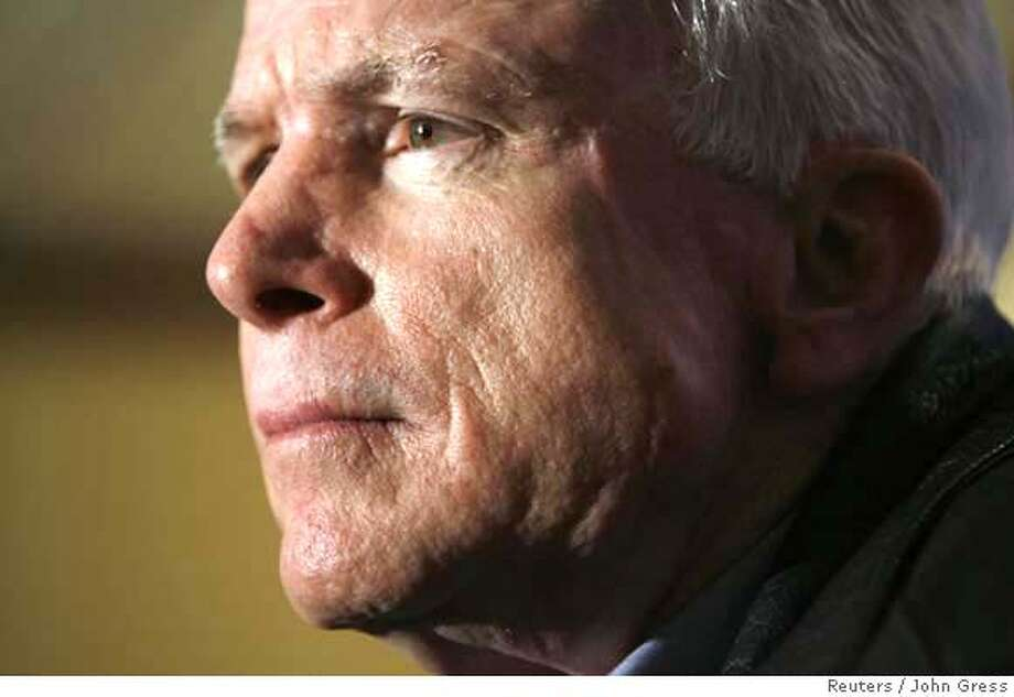 Presidential hopeful and U.S. Senator John McCain (R-AZ) speaks during a news conference after a town hall meeting in Cedar Rapids, Iowa, February 17, 2007. REUTERS/John Gress (UNITED STATES) 0 Photo: JOHN GRESS