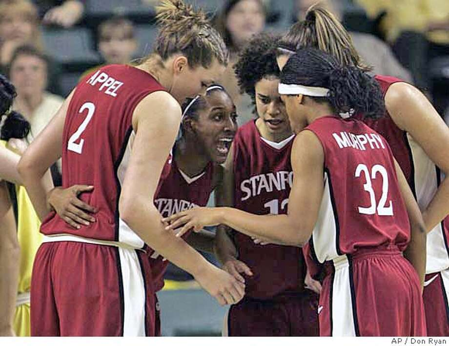 Stanford guard Candice Wiggins, second from left, huddles and talks to teammates, from left, Jayne Appel, Cissy Pierce, Brooke Smith (not visible), and Melanie Murphy during first half college basketball action against Oregon, in Eugene, Ore., Saturday, Feb. 17, 2007.(AP Photo/Don Ryan) Photo: Don Ryan
