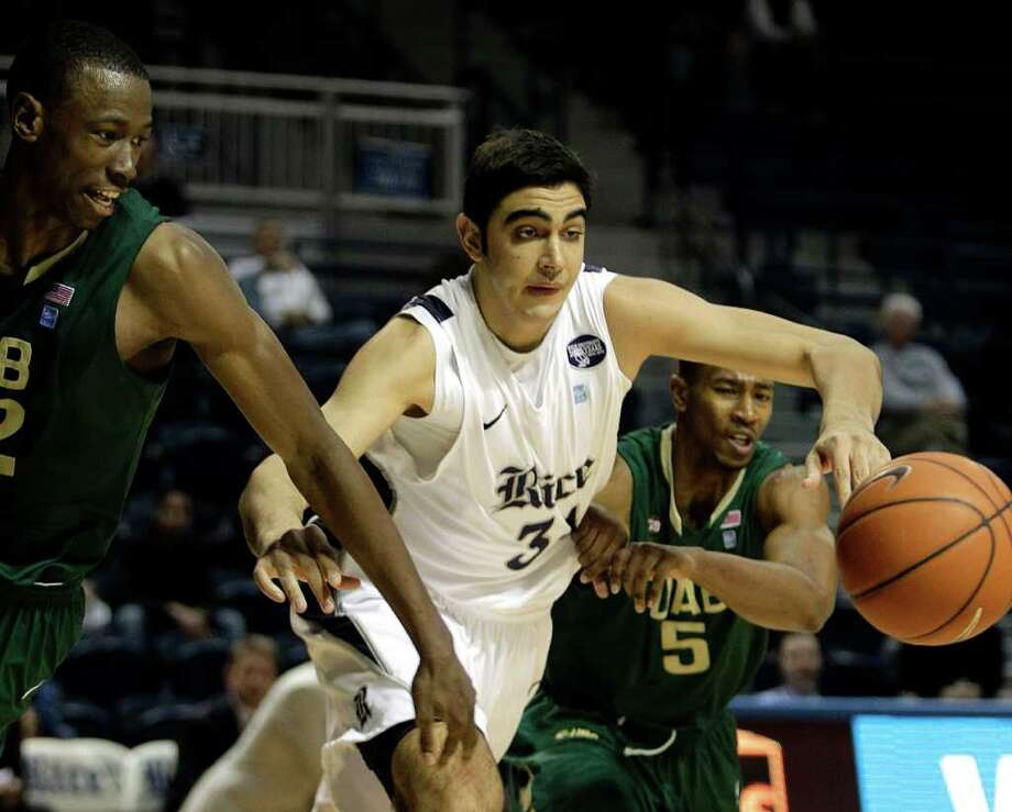 Jan. 18: UAB 61, Rice 60 (OT) — Rice center Omar Oraby, center, fights for a loose ball with UAB forward Cameron Moore, left, and UAB guard Robert Williams in overtime Wednesday at Tudor Fieldhouse. UAB beat Rice on a last-second 3-pointer by UAB's Robert Williams. Photo: Brett Coomer, Houston Chronicle / © 2012 Houston Chronicle