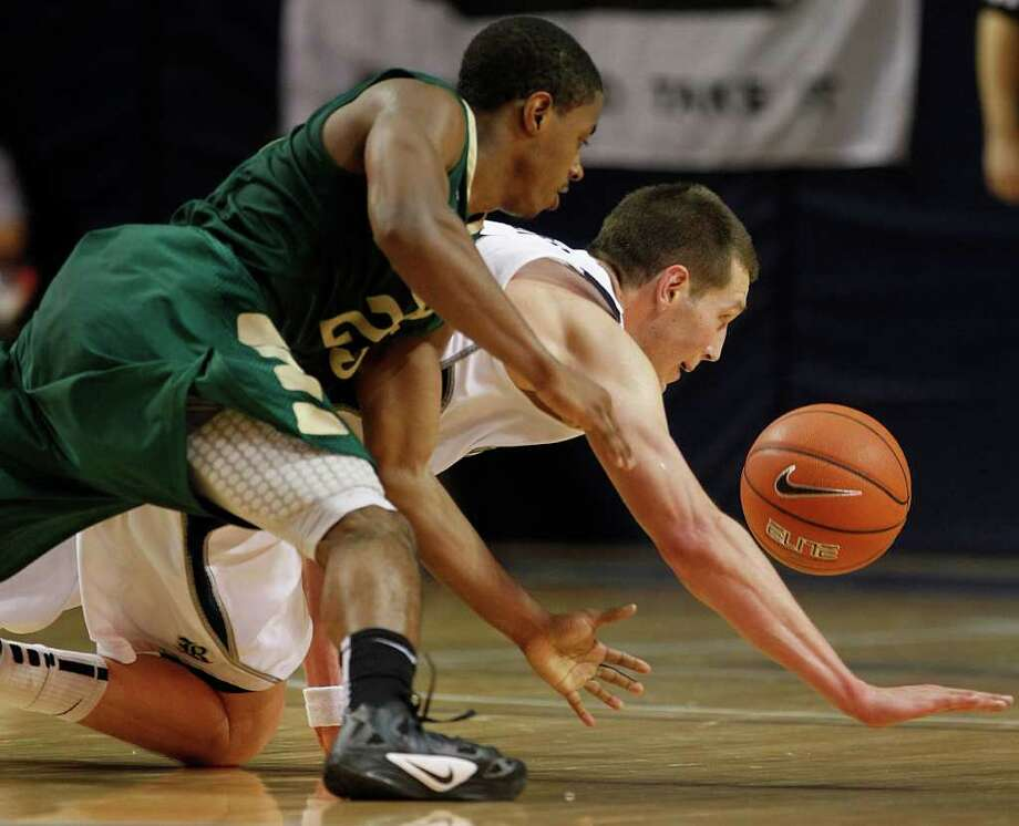UAB guard Quincy Taylor, left, and Rice forward Lucas Kuipers dive after a loose ball during the second half. Photo: Brett Coomer, Houston Chronicle / © 2012 Houston Chronicle