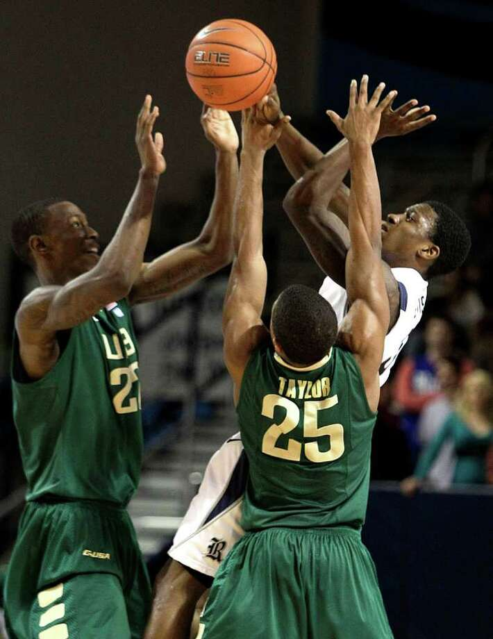 UAB forward Cameron Moore (22) and guard Quincy Taylor (25) try to block a pass by Rice guard Dylan Ennis. Photo: Brett Coomer, Houston Chronicle / © 2012 Houston Chronicle