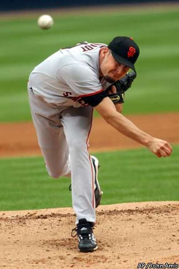 San Francisco Giants' Jason Schmidt delivers a first-inning pitch against the Atlanta Braves in Atlanta, Sunday, May 11, 2003. (AP Photo/John Amis) Photo: JOHN AMIS