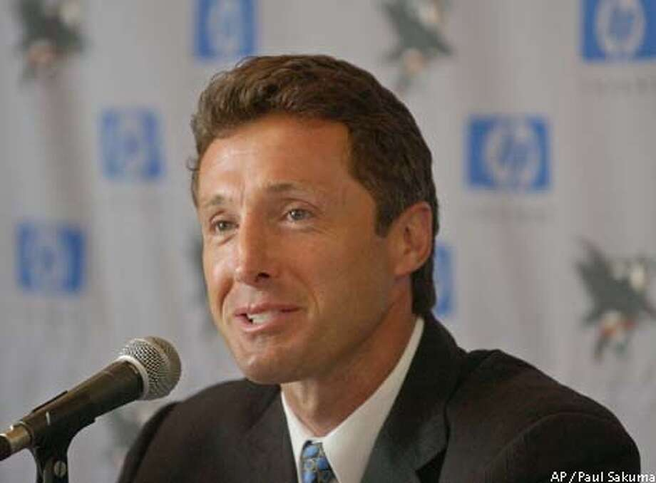Former defenseman Doug Wilson smiles during a news conference in San Jose, Calif., Tuesday, May 13, 2003, after he was named then new general manager of the San Jose Sharks. He was a former Chicago Blackhawks and San Jose Sharks defenseman. He replaces Dean Lombardi, who was fired in March. (AP Photo/Paul Sakuma) Photo: PAUL SAKUMA