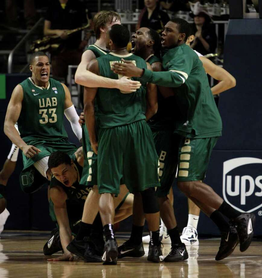 UAB players celebrate their last-second win over Rice in overtime. Photo: Brett Coomer, Houston Chronicle / © 2012 Houston Chronicle
