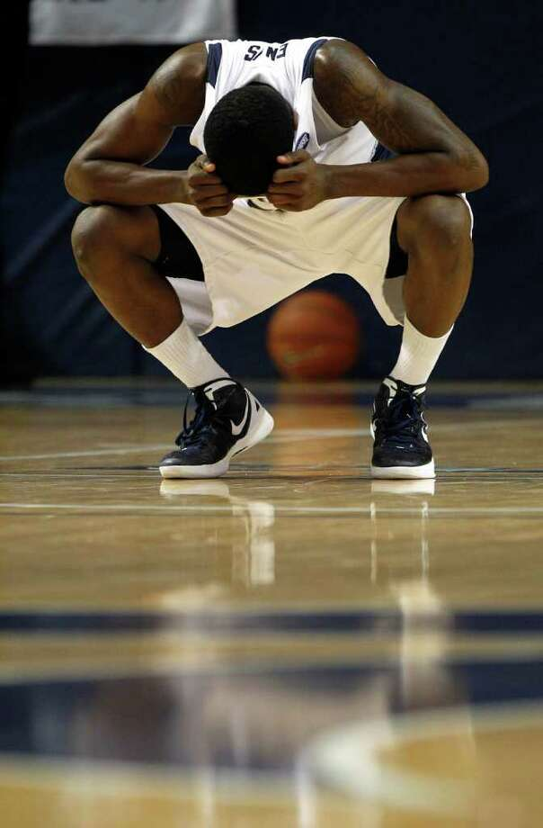Rice guard Dylan Ennis hangs his head in frustration after he and his teammates lost in overtime to UAB. Photo: Brett Coomer, Houston Chronicle / © 2012 Houston Chronicle