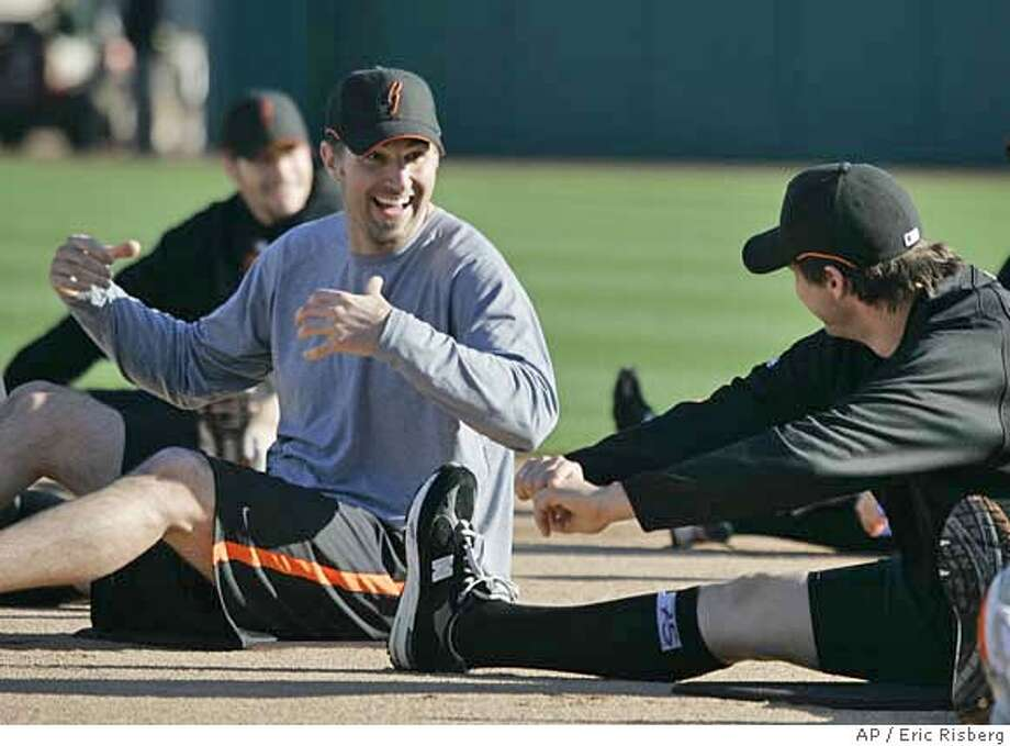 San Francisco Giants' pitcher Matt Morris, left, laughs with pitcher Barry Zito, right, while stretching during a spring training baseball workout at Scottsdale Stadium in Scottsdale, Ariz., Thursday, Feb. 15, 2007. (AP Photo/Eric Risberg) Photo: Eric Risberg
