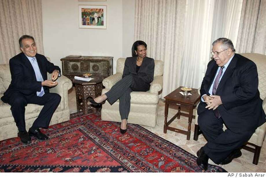 U.S. Secretary of State Condoleezza Rice, center, talks with the Iraqi President Jalal Talabani, as the U.S. ambassador in Iraq, Zalmay Khlailzad looks on in Baghdad, Iraq, Saturday, Feb. 17, 2007. The success of a new security crackdown in Baghdad will be measured largely on how well the U.S.-backed government capitalizes on any respite of sectarian violence, Rice said Saturday, during an unannounced visit to Iraq. (AP Photo/Sabah Arar/pool) Photo: SABAH ARAR