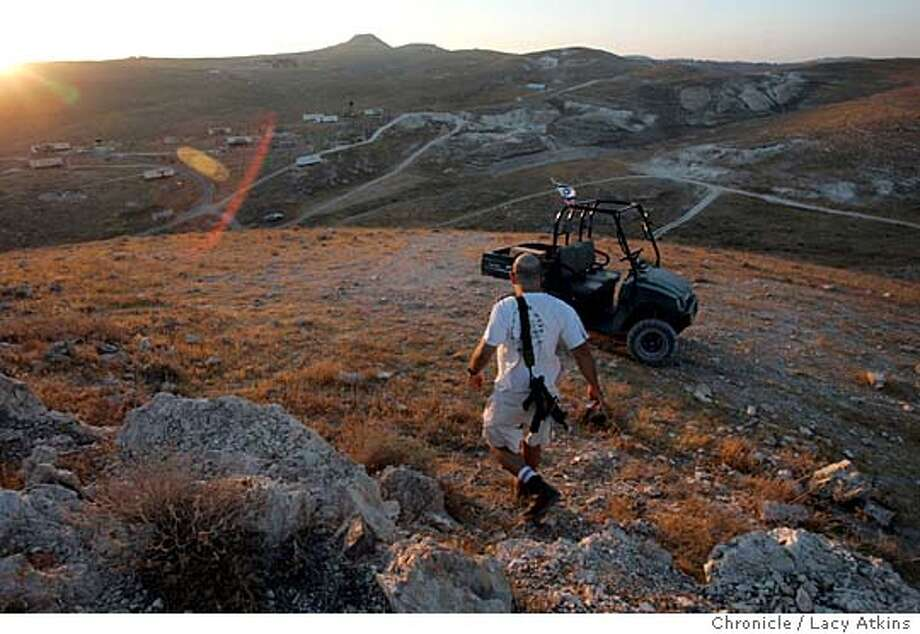 Dror Barlevav takes his nightly rounds overlooking his home village Maalah ReHavam, Aug, 3, 2005, south of Bethlehem in Israel. Dror Barlevav , Yair Halamish residents of the illegal outpost Maaleh ReHavam south of Bethlehem, August 4, 2005, in Israel. Photo by Lacy Atkins Photo: LACY ATKINS