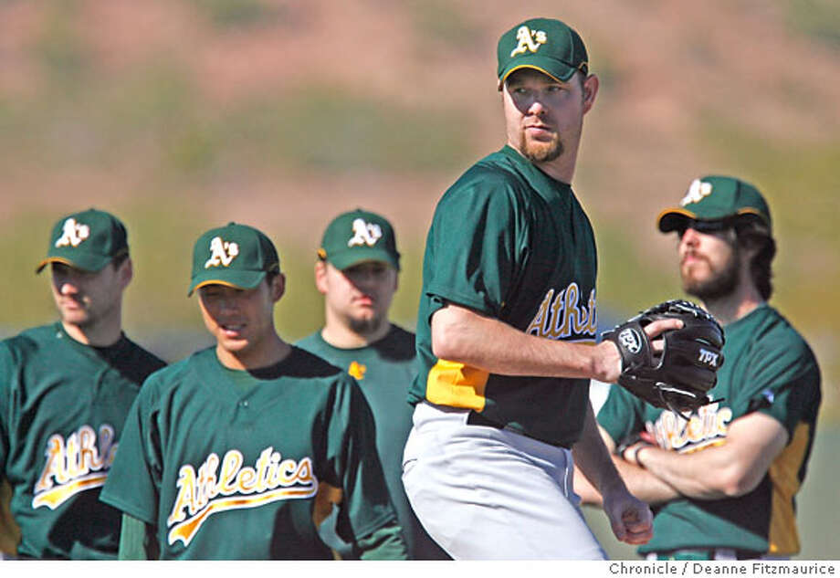 Alan Embree works on fielding drills with other pitchers behind him. The Oakland Athletics pitchers and catchers have their first workout of Spring Training at Papago Park. Photographed in Phoenix on 2/17/07. Chronicle Photo / Deanne Fitzmaurice Tim Lincecum Photo: Deanne Fitzmaurice