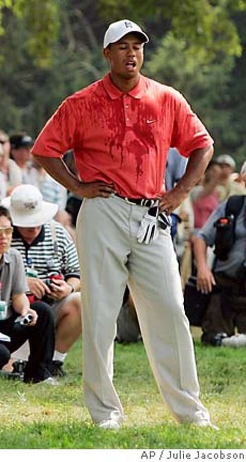Tiger Woods reacts after his tee shot on the fourth hole went in to the water during second round play in the 87th PGA Championship at the Baltusrol Golf Club in Springfield, N.J. Friday, Aug. 12, 2005. (AP Photo/Julie Jacobson) Photo: JULIE JACOBSON