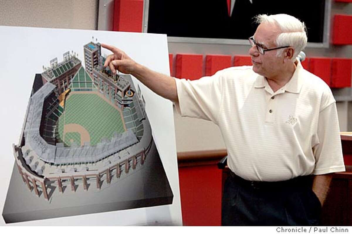 Oakland A's owner Lewis Wolff points to a rooftop swimming pool of a hotel overlooking the stadium when revealed the team's ballpark plan to the Oakland - Alameda Co. Coliseum Authority board of commissioners on 8/12/05 in Oakland, Calif. PAUL CHINN/The Chronicle