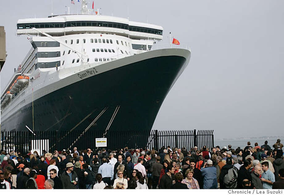 queen06_489_ls.jpg  The Queen Mary 2 towers over the Gate at Pier 27 and people who gathered in front to take a look at it. Media tours of the Queen Mary 2 and Mayor Newsom presents a proclomation to Captain Christopher Rynd on Monday, February 5, 2007. Photo by Lea Suzuki/The San Francisco Chronicle  Photo taken on 2/5/07, in San Francisco, CA. **(themselves) cq. Ran on: 02-18-2007  The Queen Mary 2 towers over San Francisco at Pier 27 as huge crowds of people gather in front to take a look at it. Photo: Lea Suzuki