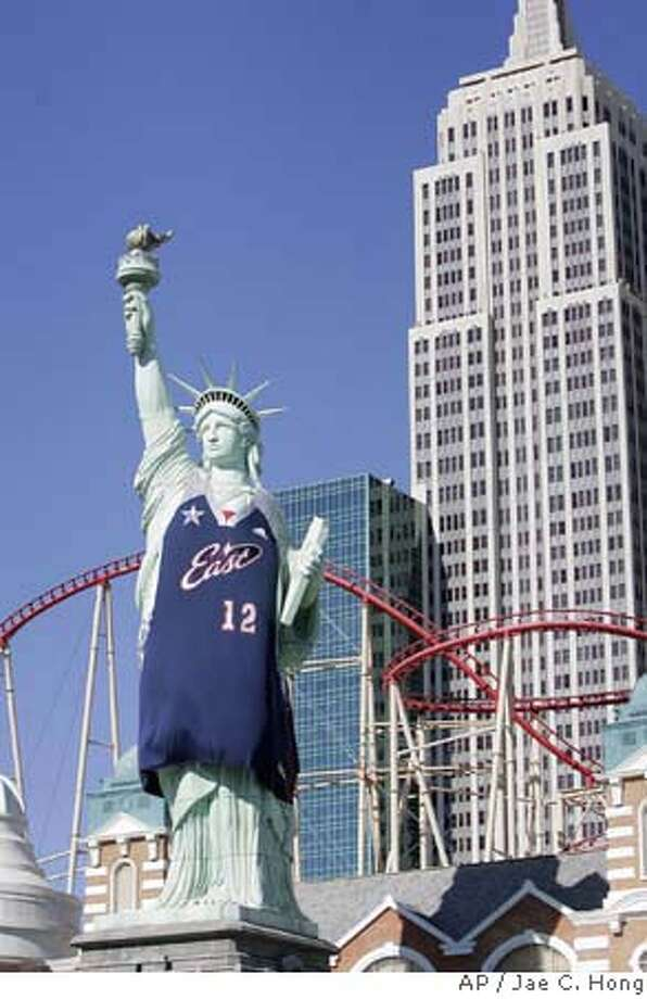 A replica of the Statue of Liberty is draped with a new NBA All-Star basketball jersey at New York New York hotel-casino in Las Vegas on Wednesday, Feb. 14, 2007. (AP Photo/Jae C. Hong) Photo: Jae C. Hong
