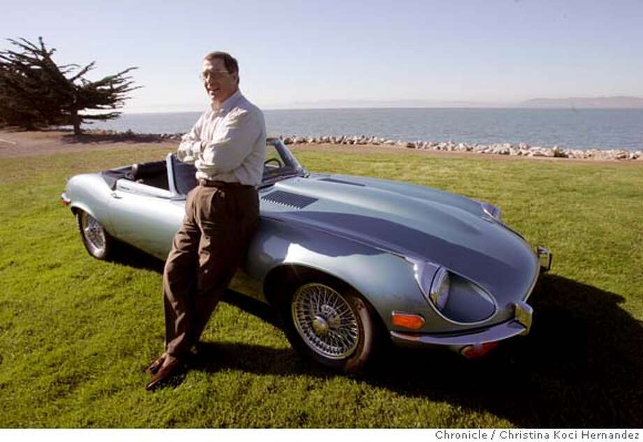 Shot in Alameda, with the Bay as background.Tony Theophilos, SF lawyer, and his 1972 Jaguar XKE convertible. car is at the home of a friend in alameda. (CHRISTINA KOCI HERNANDEZ/THE CHRONICLE) Ran on: 02-18-2007  Tony Theophilos poses in Alameda with his 1972 Jaguar Series III E-type convertible with the V12 engine. He bought it at the Pebble Beach auction.  Ran on: 02-18-2007 Ran on: 02-18-2007 Ran on: 02-18-2007 Photo: Christina Koci Hernandez