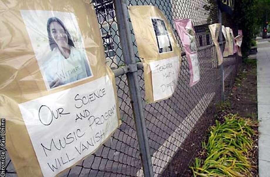 budget070_pc.jpg Washington Elementary School teachers facing layoffs have hung photographs of pink-slipped staff on 5/14/03 in Berkeley. PAUL CHINN / The Chronicle Photo: PAUL CHINN