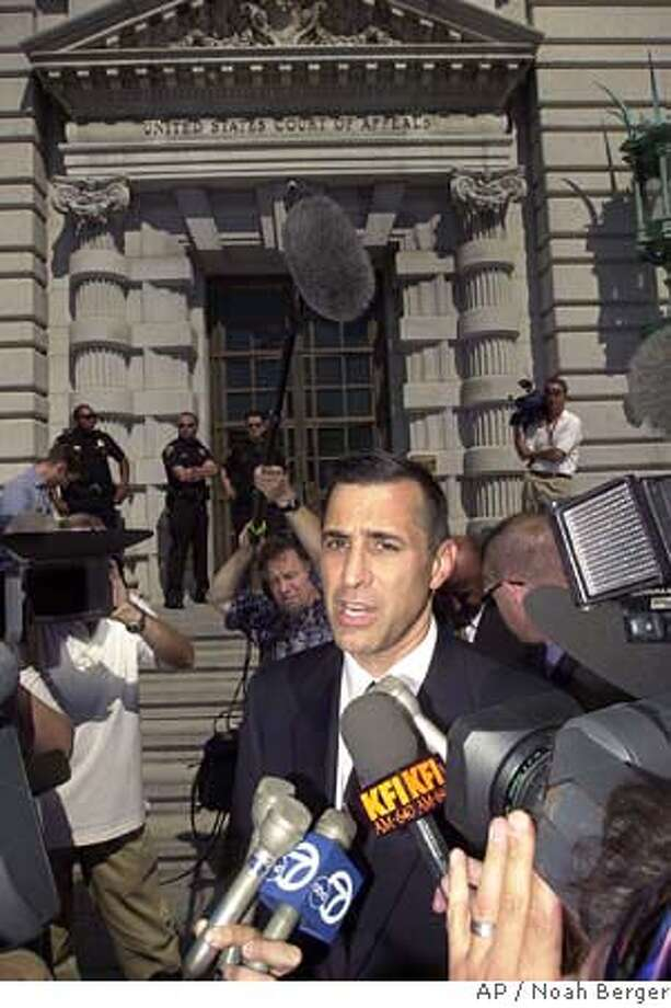 Rep. Darrell Issa, R-Calif., speaks to reporters outside of the 9th U.S. Circuit Court of Appeals chambers Monday, Sept. 22, 2003, in San Francisco. Issa, who bankrolled the initial recall effort, said he hopes the court clears the way for an Oct. 7 special election. (AP Photo/Noah Berger) CAT Photo: NOAH BERGER