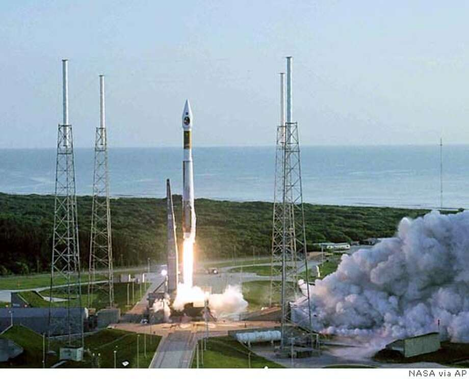 In this handout photo provided by NASA, the Atlas V launch vehicle carrying the Mars Reconnaissance Orbiter, MRO, lifts off the pad at the Cape Canaveral Air Force Station in Cape Canaveral, Fla. Friday, Aug. 12, 2005. Circling the planet for at least four years, the orbiter is to provide information on Mars' weather, climate and geology, which could aid possible future human exploration of the Red Planet. (AP Photo/NASA)