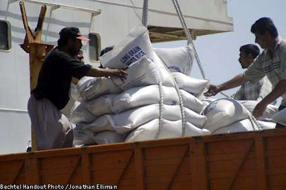 IMG_0144.JPG For BECHTEL; Rice being unloaded from a U.S. Agency for International Development ship at Umm Qasr after successful dredging of the port. May 5, 2003. Photo: Jonathan Elliman for Bechtel; 5/8/03 . Jonathan Elliman for Bechtel / HO Photo: Jonathan Elliman For Bechtel