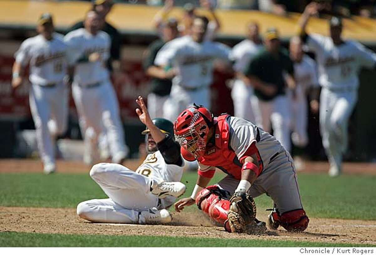 Jason Kendoll Scores off an error on Francisco Rodriguez in the 9th as he just missed the tag by Jose Molina to wen the game . Los Angeles Angels of Anaheim vs. Oakland Athletics . 8/11/05 in Oakland,CA. KURT ROGERS/THE CHRONICLE