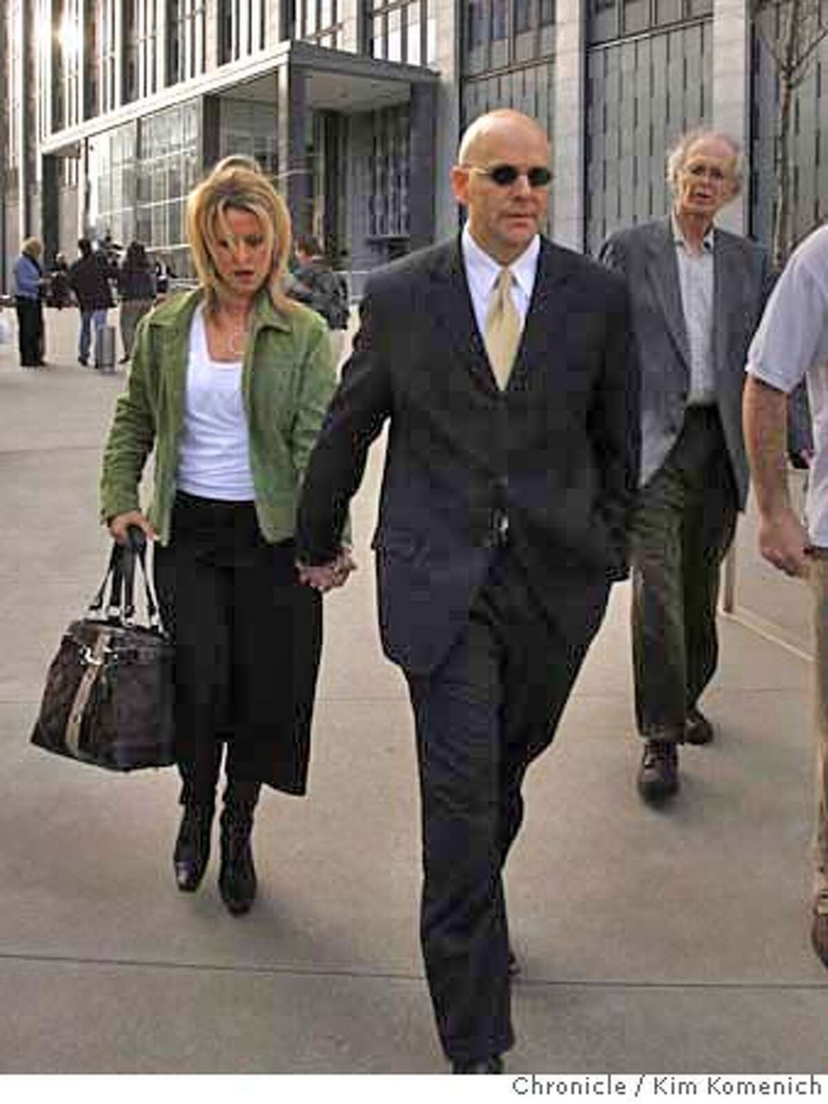 Attorney Troy Ellerman and unidentified companion exit the Federal Building in San Francisco after he leaking files in the BALCO case. The admission caused federal prosecutors to lift the subpoena against Chronicle reporters Mark Fainaru-Wada and Lance Williams. Photo by Kim Komenich/The Chronicle.