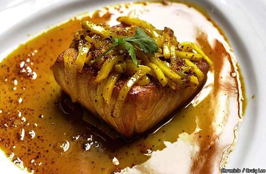 Chef Khai Duong at Ana Mandara restaurant at Ghirardelli Square. Photo of Chef Khai Duong's Seared Salmon with Fresh Mango. 5/1/03 in San Francisco.  CRAIG LEE / The Chronicle Photo: CRAIG LEE