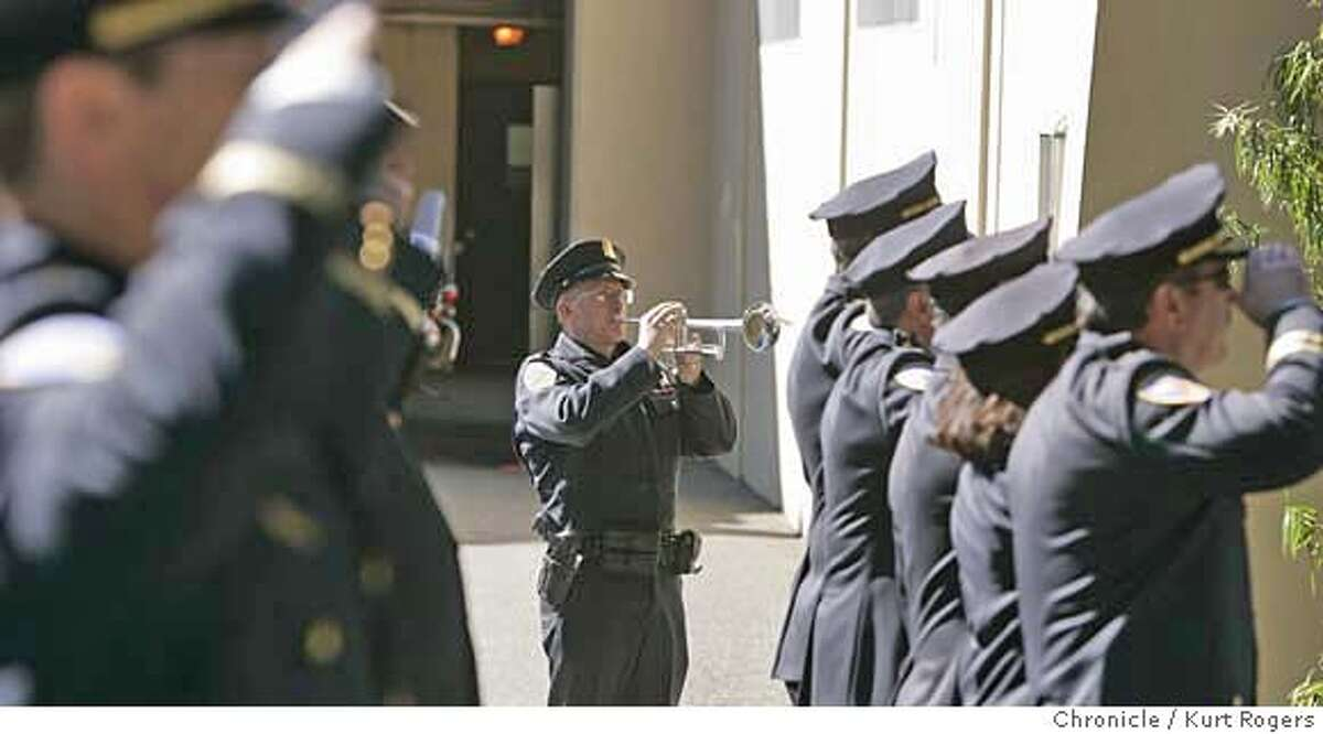 Officer Mark Lundin plays Taps Ceremony and plaque unveiling for anniversary of 1970 bomb blast at San Francisco's Park Station, police station, that killed police Sgt. Brian McDonnell and injured eight others. FRIDAY, FEBRUARY 16, 2007 KURT ROGERS/THE CHRONICLE SAN FRANCISCO THE CHRONICLE SFC PARKSTATION17_0134_kr.jpg MANDATORY CREDIT FOR PHOTOG AND SF CHRONICLE / NO SALES-MAGS OUT