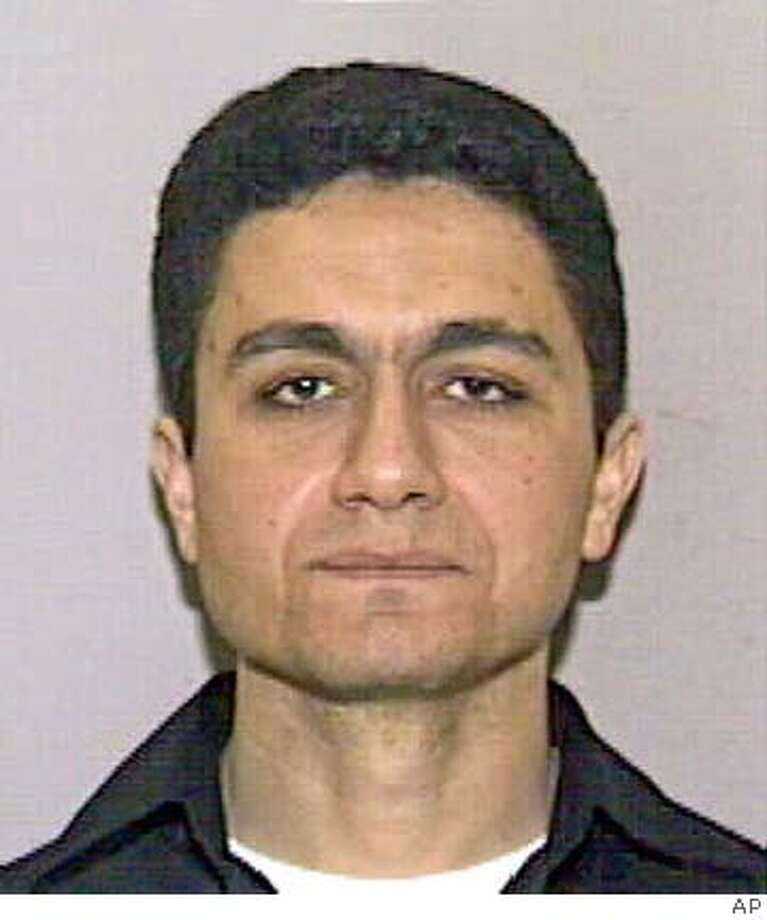 ** FILE ** This image originally made available Wednesday, Sept. 12, 2001 by the State of Florida Division of Motor Vehicles shows Mohammed Atta. The Sept. 11 commission will investigate a claim that U.S. defense intelligence officials identified ringleader Mohammed Atta and three other hijackers as a likely part of an al-Qaida cell more than a year before the Sept. 11, 2001 airplane hijackings but didn't forward the information to law enforcement. (AP Photo) MAGE ORIGINALLY MADE AVAILABLE SEPT. 12, 2001 BY THE STATE OF FLORIDA DIVISION OF MOTOR VEHICLES