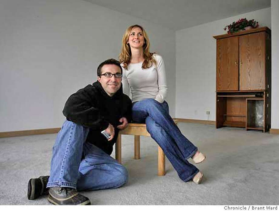 housing126.JPG  Allan and Sarah Buehler in the living room of their new condo.  Sarah and Allan Buehler are home buyers who recently purchased a condominium in the Twin Peaks area for $583,000.{Brant Ward/San Francisco Chronicle}2/11/07 Photo: Brant Ward